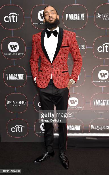 Nipsey Hussle arrives at the Warner Music Group PreGrammy Celebration at Nomad Hotel Los Angeles on February 7 2019 in Los Angeles California