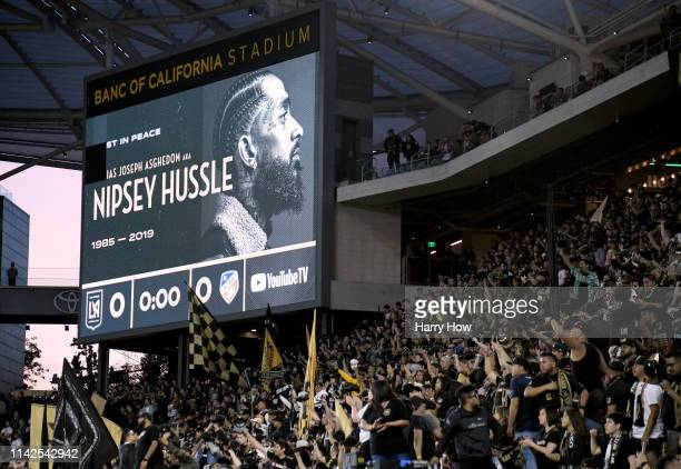 Nipsey Hussle is recognized before the game between the FC Cincinnati and the Los Angeles FC at Banc of California Stadium on April 13 2019 in Los...