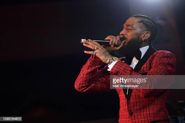 Nipsey Hussle performs onstage at the Warner Music PreGrammy Party at the NoMad Hotel on February 7 2019 in Los Angeles California