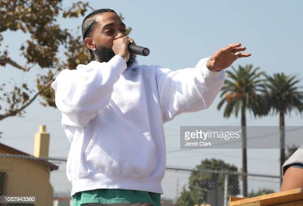 Nipsey Hussle speaks to kids at the Nipsey Hussle x PUMA Hoops Basketball Court Refurbishment Reveal Event on October 22 2018 in Los Angeles...