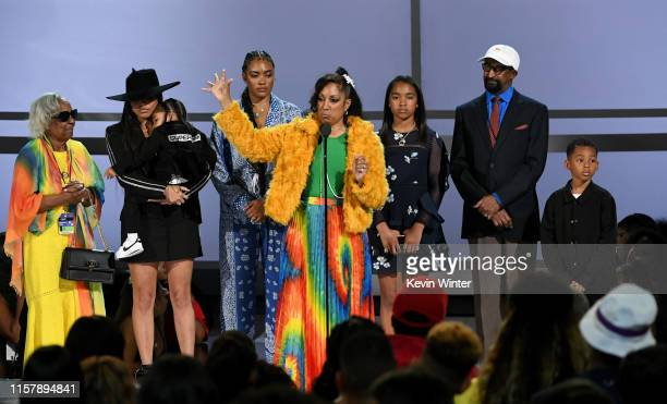 Nipsey Hussle's family Lauren London Kross Ermias Asghedom Samantha Smith Angelique Smith Emani Asghedom and Dawit Asghedom accept the Humanitarian...