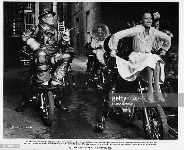 Nipsey Russell as the Tin Man Ted Ross as the Lion and Diana Ross as Dorothy ride motorcycles in a scene for the Universal Studios movie The Wiz...