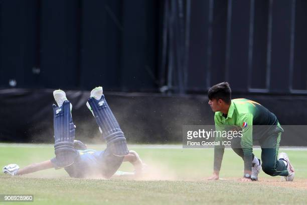 Nipun Dhanajaya slides in for Sri Lanka during the ICC U19 Cricket World Cup match between Sri Lanka and Pakistan at Cobham Oval on January 19 2018...