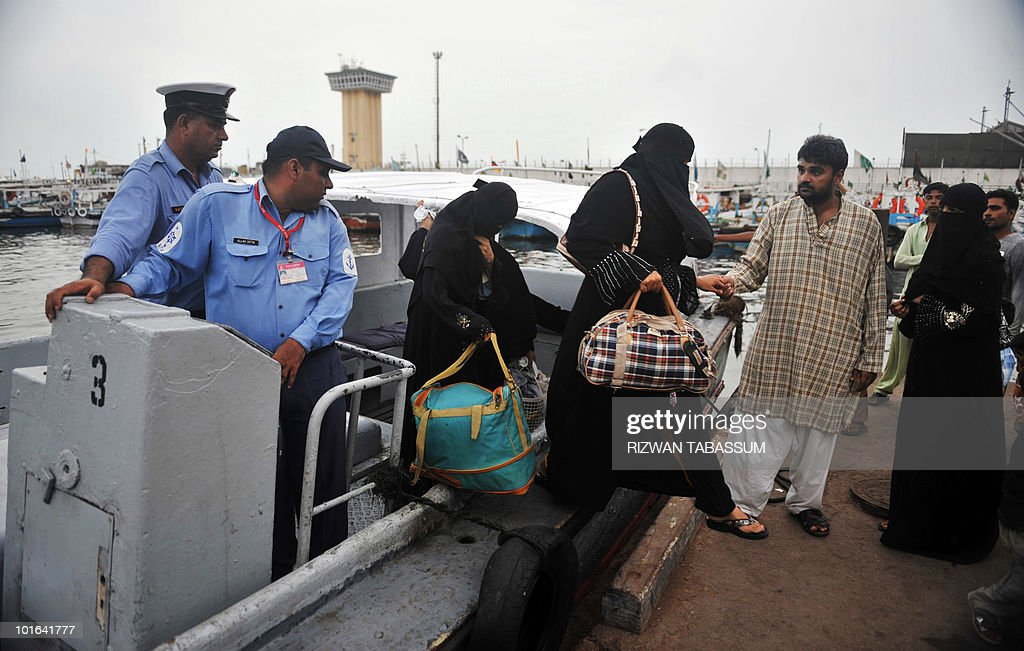 Niqab-wearing Pakistani women who abandoned their homes on the tiny island of Baba, an approximate 15-minute boat ride from Karachi, disembark in Karachi on June 5, 2010. Hundreds of families are being shifted by the authorities from various islands and coastal neighborhoods of the southern port city to save them from tropical Cyclone Phet, which has killed 15 people and left two missing in Oman before barrelling towards Pakistan, a civil defence force official said. AFP PHOTO/Rizwan TABASSUM