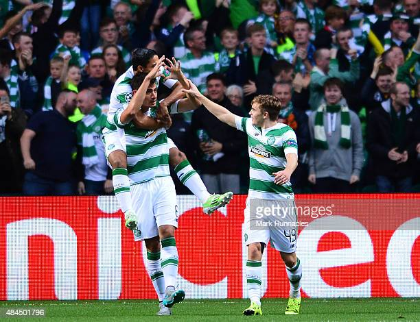 Nir Bitton of Celtic celebrates scoring in the first half with team mates during the UEFA Champions League Qualifying play off first leg match,...