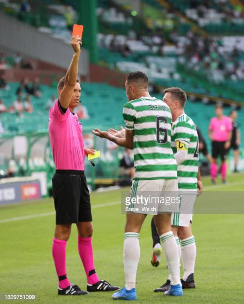 Nir Bitton of Celtic is shown a red card by Referee Sandro Scharer after clashing with Anders Dreyer of FC Midtylland during the UEFA Champions...