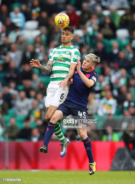 Nir Bitton of Celtic outjumps Connor Smith of Hearts during the Ladbrokes Scottish Premiership match between Celtic and Hearts at Celtic Park on May...