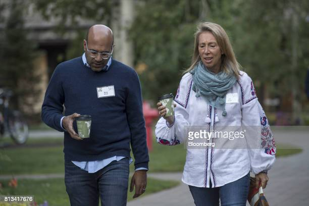 Niraj Shah chief executive officer and cofounder of Wayfair LLC left and wife Jill Shah arrive for a morning session during the Allen Co Media and...