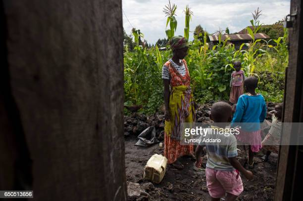 Niraneza Judith wife of Fabien Moyram greets two of her children as they return from school at home in Goma in the Democratic Republic of Congo...