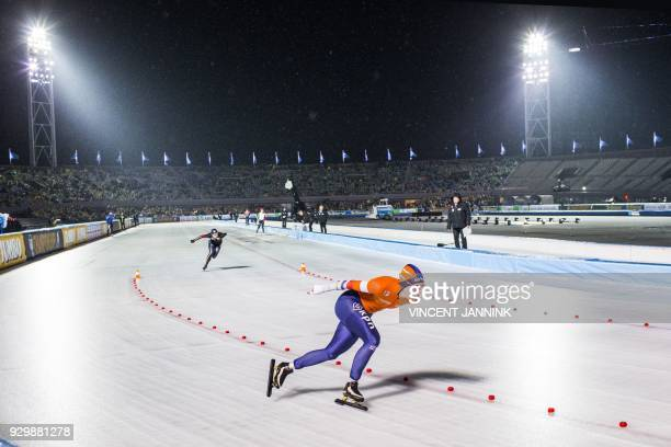 nIreen Wust from the Netherlands gestures after competing against Gabriele Hirschbichler from Germany after the 500 meter race at the ISU World Cup...