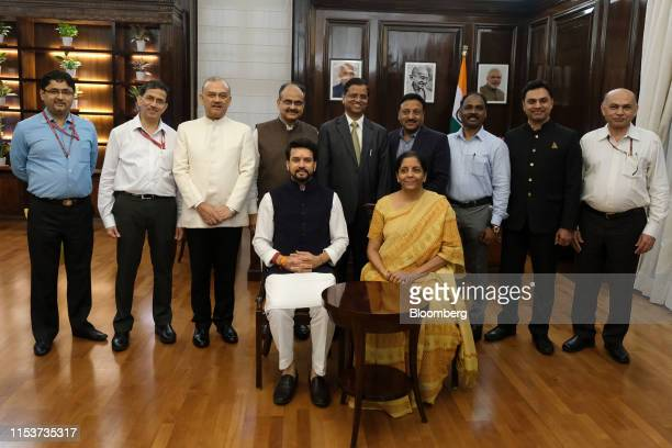 Nirmala Sitharaman India's finance minister center right sits beside Anurag Thakur India's finance and corporate affairs minister during the budget...
