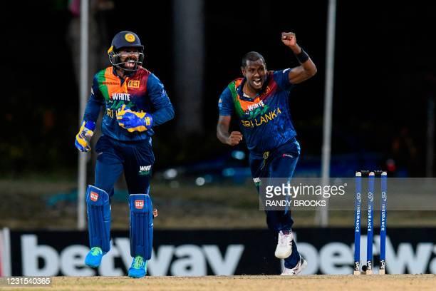 Niroshan Dickwella and Angelo Mathews of Sri Lanka celebrate the dismissal of Chris Gayle of West Indies during the 2nd T20i match between Sri Lanka...