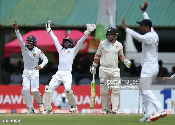 Niroshan Dickwella and Kusal Mendis unsuccessful appeal for wicket of Tom Latham of New Zealand during the day three of Second Test match between Sri...