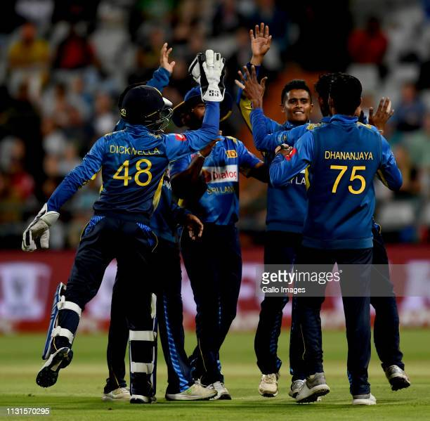 Niroshan Dickwella and teammates of Sri Lanka celebrate the wicket of Faf du Plessis of South Africa during the 1st KFC T20 International match...