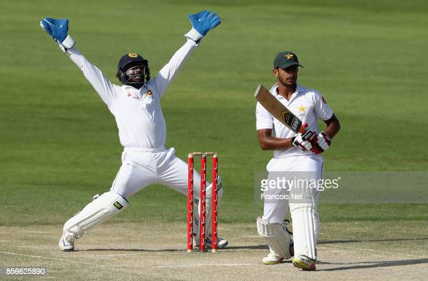 Niroshan Dickwella of Sri Lanka appeals for the wicket of Hasan Ali during Day Five of the First Test between Pakistan and Sri Lanka at Sheikh Zayed...