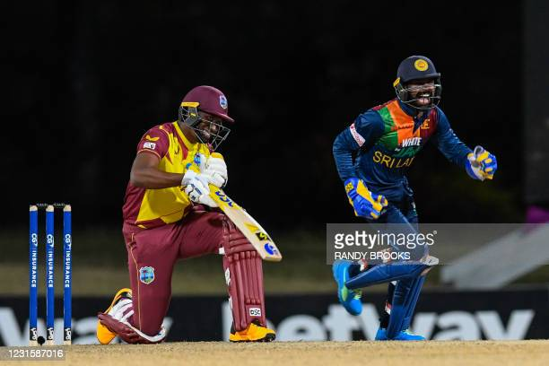 Niroshan Dickwella of Sri Lanka celebrates the dismissal of Dwayne Bravo of West Indies during the 3rd and final T20i match between Sri Lanka and...