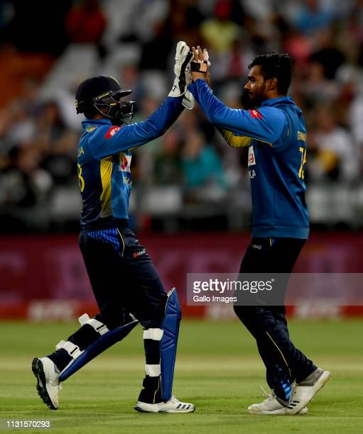 Niroshan Dickwella of Sri Lanka celebrates the wicket of Faf du Plessis of South Africa with a teammate during the 1st KFC T20 International match...
