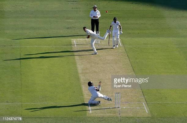 Niroshan Dickwella of Sri Lanka hits Mitchell Starc of Australia for 6 runs during day one of the First Test match between Australia and Sri Lanka at...