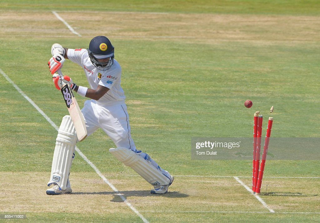Niroshan Dickwella of Sri Lanka is being dismissed by Hasan Ali of Pakistan during Day Two of the First Test between Pakistan and Sri Lanka at Sheikh Zayed Stadium on September 29, 2017 in Abu Dhabi, United Arab Emirates.