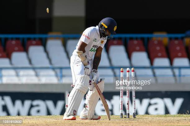 Niroshan Dickwella of Sri Lanka is bowled by Kemar Roach of West Indies during day 4 of the 1st Test between West Indies and Sri Lanka at Vivian...