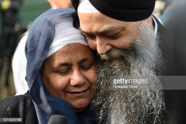 Nirpreet Kaur, an eye-witness of the 1984 Sikh massacre, and AAP leader Jarnail Singh rejoice the Delhi High Court judgement sentencing Congress...