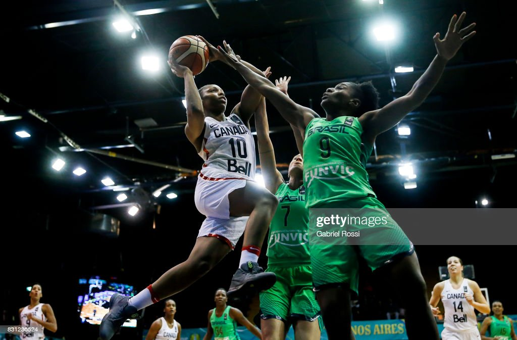 Nirra Fields of Canada (L) is blocked by Jaqueline De Paula of Brazil (R) during a match between Canada and Brazil as part of the FIBA Women's AmeriCup Semi Final at Obras Sanitarias Stadium on August 12, 2017 in Buenos Aires, Argentina.