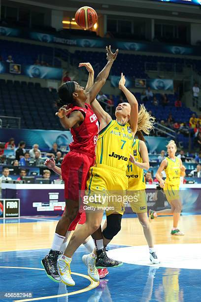 Nirra Fields of Canada jumps for the ball with Penny Taylor of Australia during the 2014 FIBA Basketball World Cup match between Australia and Canada...
