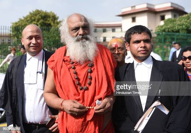 Nirvani Akhara chief Mahant Dharam Das along with lawyers addresses to media after the Ram janmbhumi case hearing at Supreme court on July 6 2018 in...
