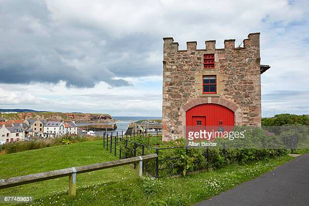 Nisbets tower with Eyemouth fishing harbour