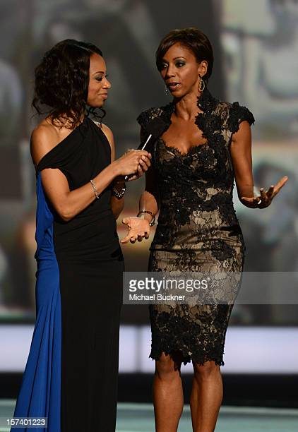 Nischelle Turner and Holly Robinson Peete speak onstage during the CNN Heroes An All Star Tribute at The Shrine Auditorium on December 2 2012 in Los...