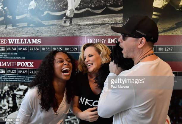 Nischelle Turner interviews Jenny McCarthy and Donnie Wahlberg on the set as Jenny McCarthy hosts her SiriusXM Show backstage at Fenway Park in...