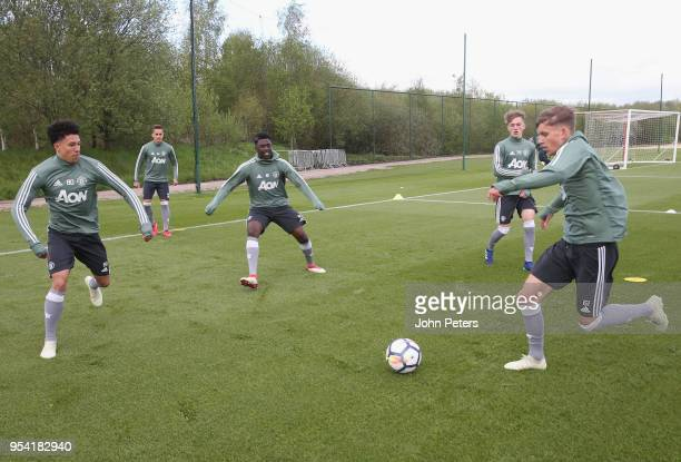Nishan Burkart Aliou Traore and Dion McGhee at Aon Training Complex on May 2 2018 in Manchester England