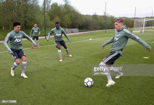 Nishan Burkart and Dion McGhee of Manchester United U18s in action during an U18s training session at Aon Training Complex on May 2 2018 in...