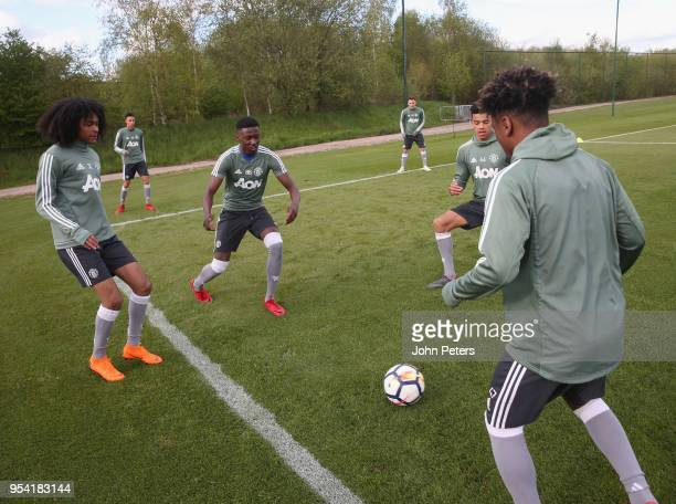 Nishan Burkart Di'Shon Bernard and Angel Gomes of Manchester United U18s in action during an U18s training session at Aon Training Complex on May 2...