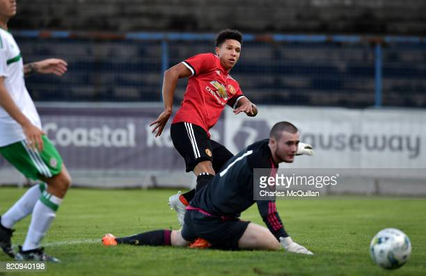 Nishan Burkart of Manchester United sees his shot saved Connor Larkin of Northern Ireland during the NI Super Cup game between Manchester United u18s...