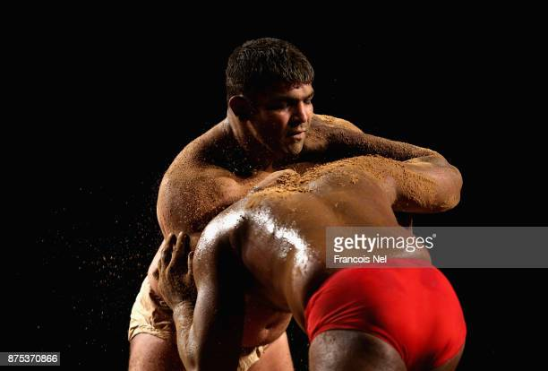 Nishant Pahelwan of India competes against Malo Pahelwan of Pakistan during The Indo-Pak Kushti Wrestling Championship at Hamdan Sports Complex on...