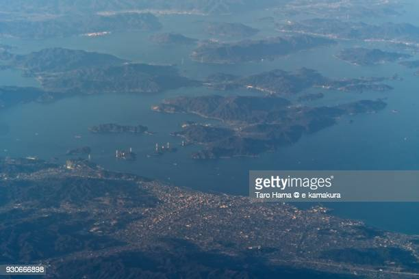 Nishiseto Expressway (Shimanami Kaido) on Seto Inland Sea and Imabari city in Ehime prefecture in Japan daytime aerial view from airplane