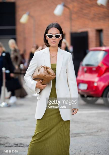 Nisi Kastull is seen wearing green dress white blazer outside By Malene Birger during Copenhagen Fashion Week Spring/Summer 2020 on August 08 2019 in...