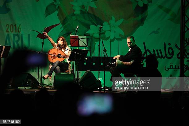 Nisreen Hmaidan performs during the eighth edition of the Arij Palestine Nights for Music in the Baddawi Palestinian Camp north of the Lebanese port...