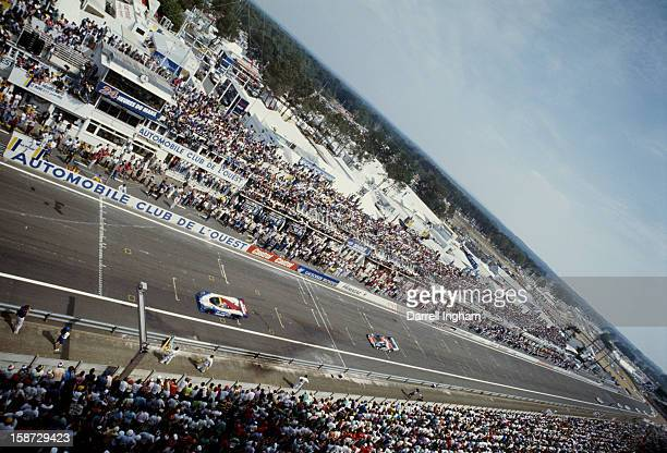 Nissan and Porsche run the front straight during the FIA World Sportscar Championship 24 Hours of Le Mans race on 16th June 1990 at the Circuit de la...