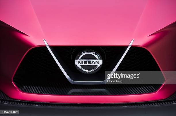A Nissan badge sits on the grill of a Nissan Concept 2020 Vision Gran Turismo concept vehicle displayed at Nissan Motor Co's Nissan Crossing showroom...