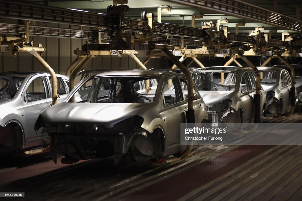 Nissan car body shells make their way along an automated conveyor system on the production line at Nissan's Sunderland plant on January 24, 2013 in Sunderland, England. The Japanese manufacturer's factory employs 6,225 people producing the Juke, Note and Qashqai models. In 2012 the Wearside facility built 510,572 cars to become the first ever UK automobile plant to have produced more than half a million cars in a year, which was 34.8 percent of the cars produced in the whole of the UK for 2012.