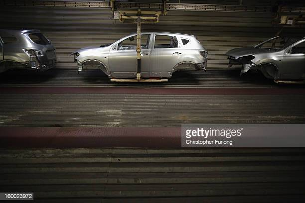 Nissan car body shells make their way along an automated conveyor system on the production line at Nissan's Sunderland plant on January 24 2013 in...
