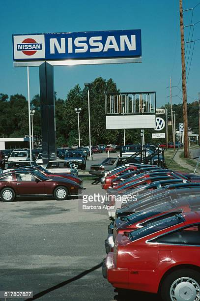 A Nissan car dealership forecourt in Detroit Michigan USA October 1988