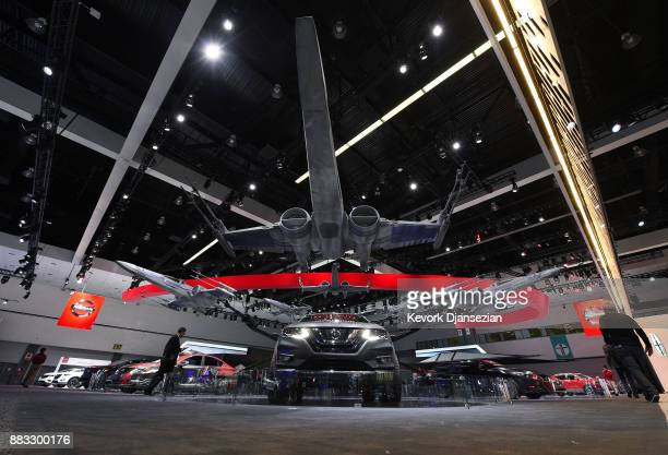 Nissan cars are adorned with various 'Star Wars' characters and spacecraft during the auto trade show AutoMobility LA at the Los Angeles Convention...
