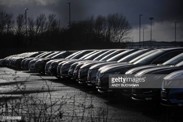 Nissan cars are pictured parked in a lot at its' Sunderland plant in north east England on March 16 2019 Carmakers are facing fallout from Britain's...