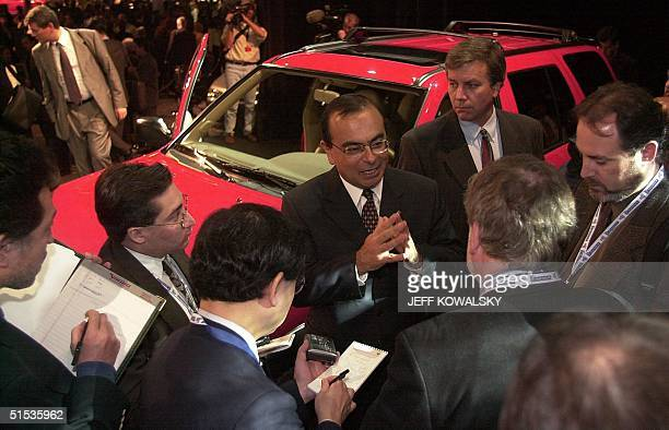 Nissan Chief Operating Officer Carlos Ghosh talks to reporters at the North American International Auto Show in Detroit 11 January 2000 Nissan...