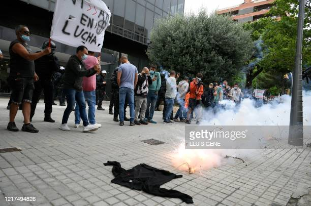 Nissan employees light firecrackers to protest against the closure of the Japanese cars manufacturer's plant in Barcelona on June 04 2020 Japanese...
