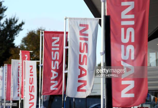 Nissan flags fly at a Nissan car dealership in Sunderland north east England on October 25 2016 Japanese car giant Nissan announced on October 27...