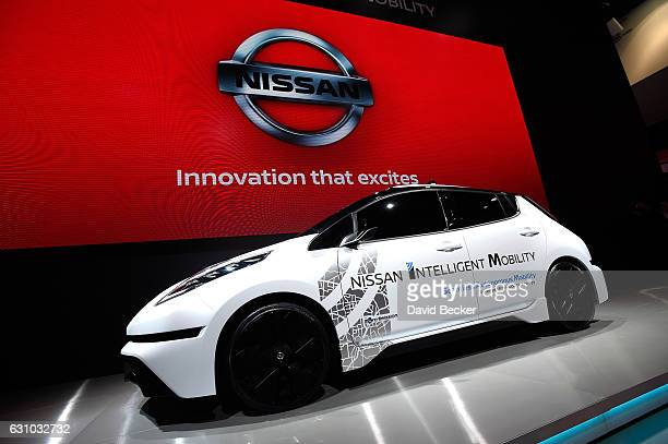 Nissan Leaf an electric vehicle is displayed at the Nissan Booth at CES 2017 at the Las Vegas Convention Center on January 5 2017 in Las Vegas Nevada...
